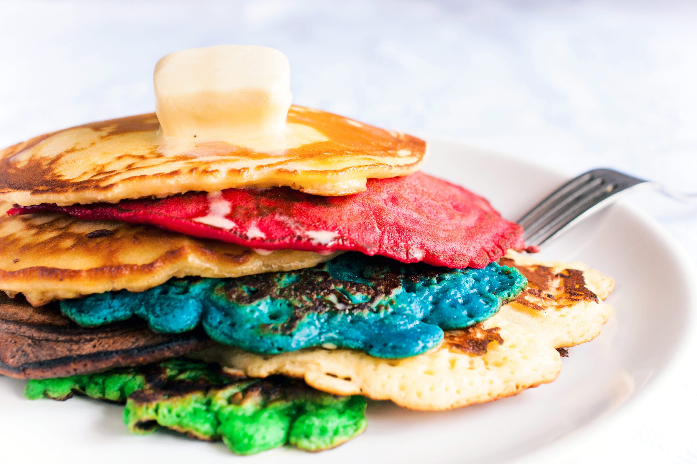 9 easy ways to make pancakes more delicious readers digest rainbow pancakes ccuart Image collections