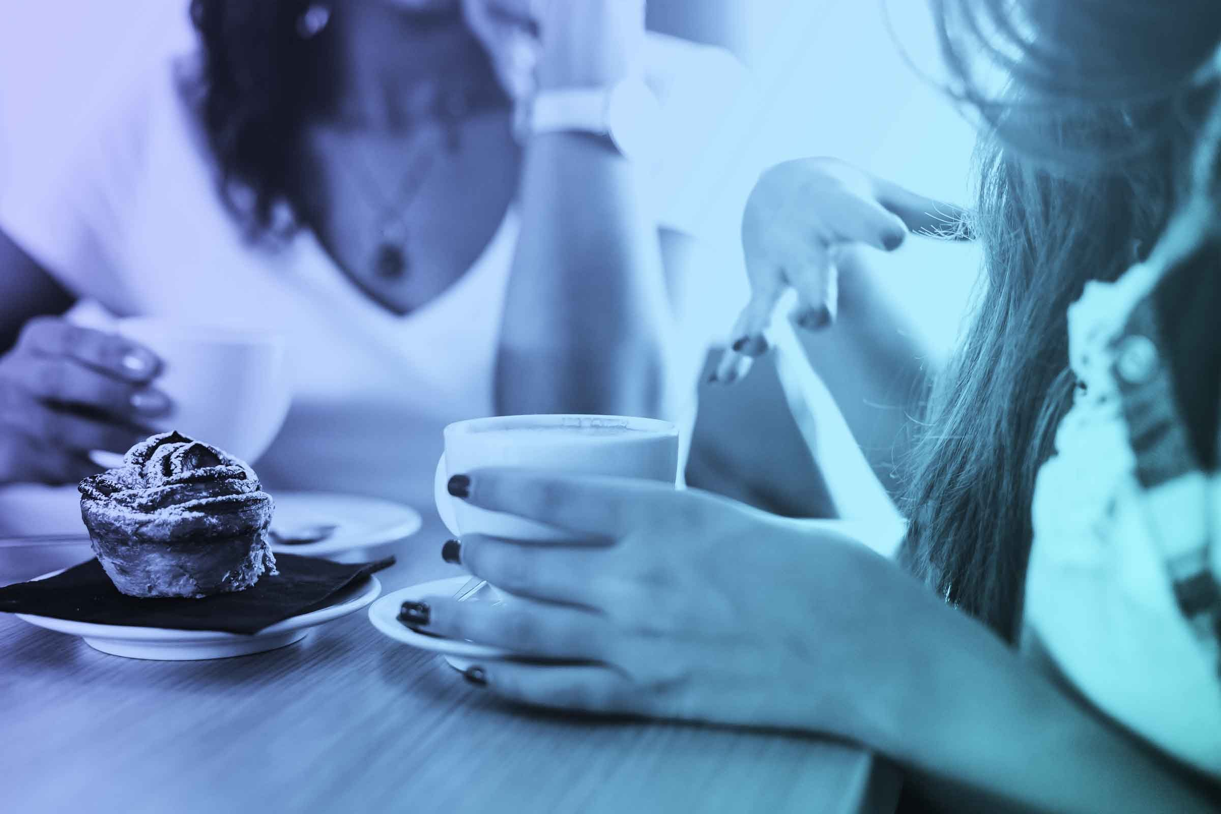 two female friends chatting over coffee