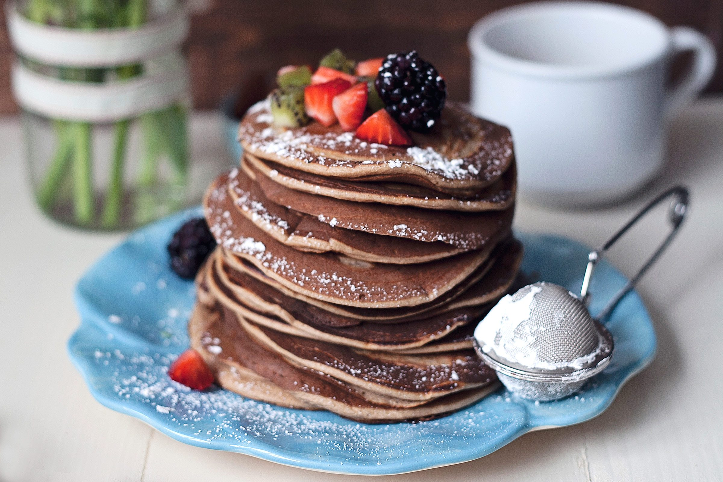 9 easy ways to make pancakes more delicious readers digest double chocolate pancakes ccuart Image collections