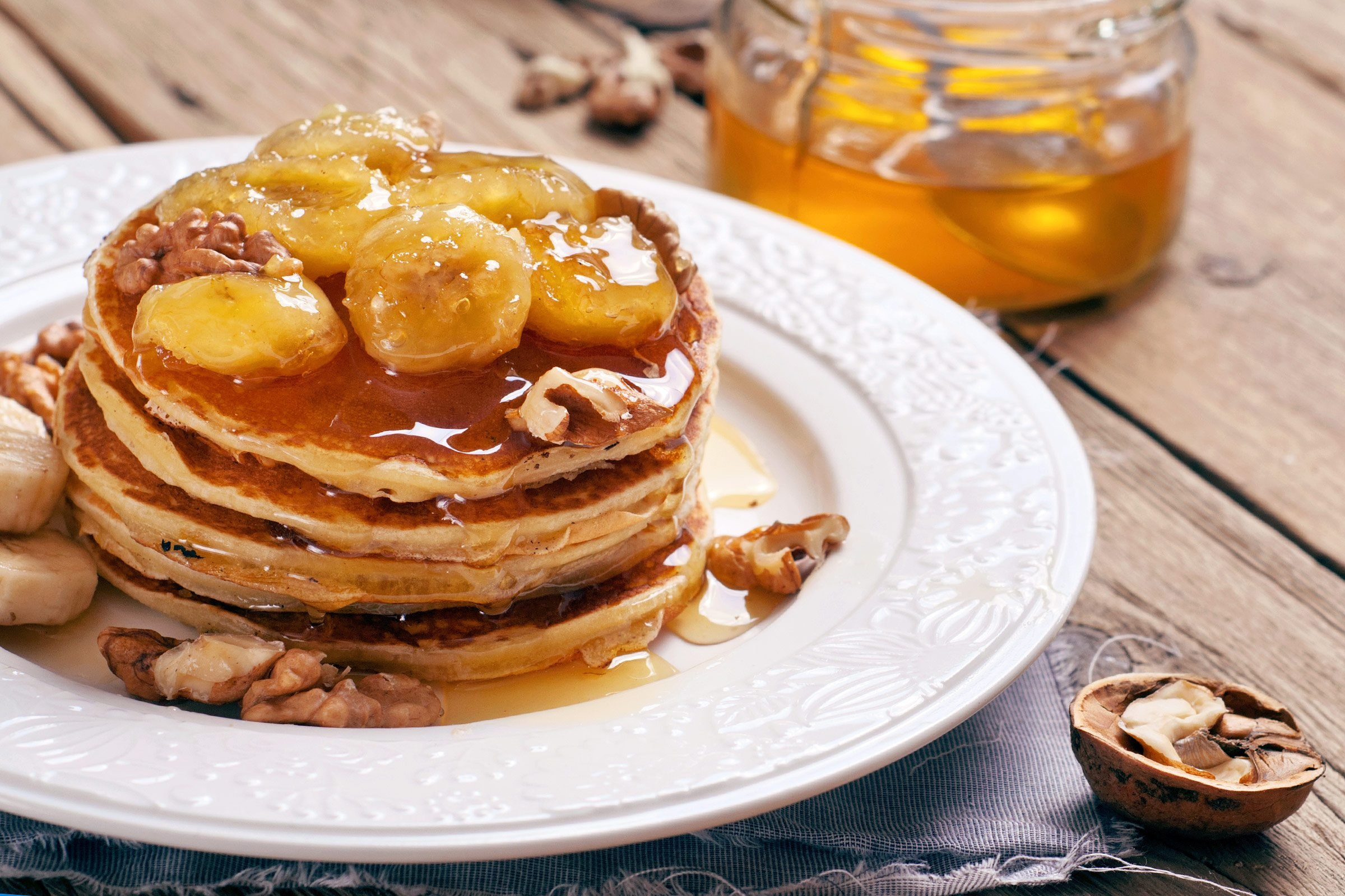 9 easy ways to make pancakes more delicious readers digest caramelized bananas pancakes ccuart Image collections
