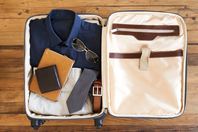 Airline travel tip man's suitcase packed