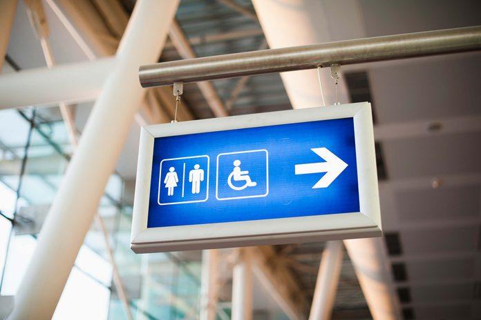 Airplane travel tip bathroom sign