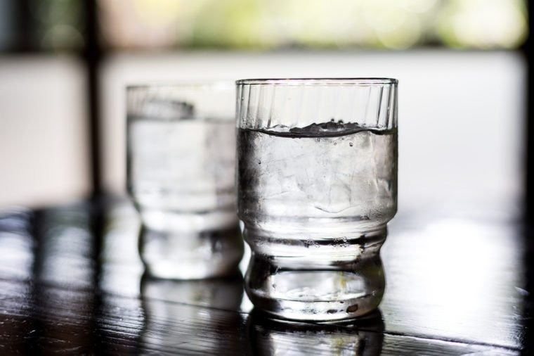 Glass of water on table in restaurant
