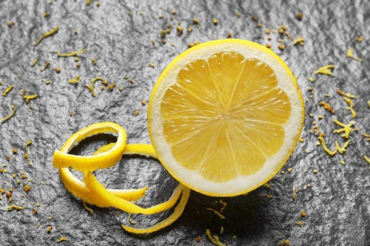 Half of fresh lemon on dark background