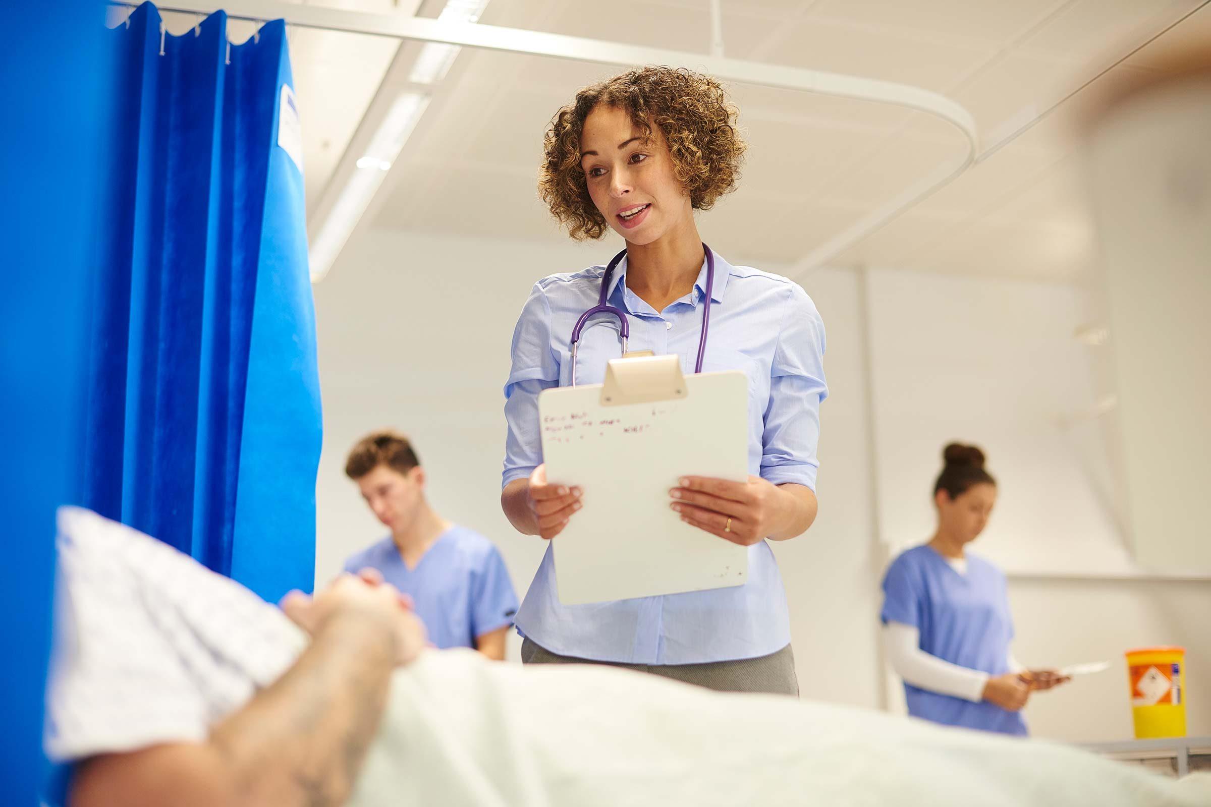 Man in hospital getting hand job by nurse