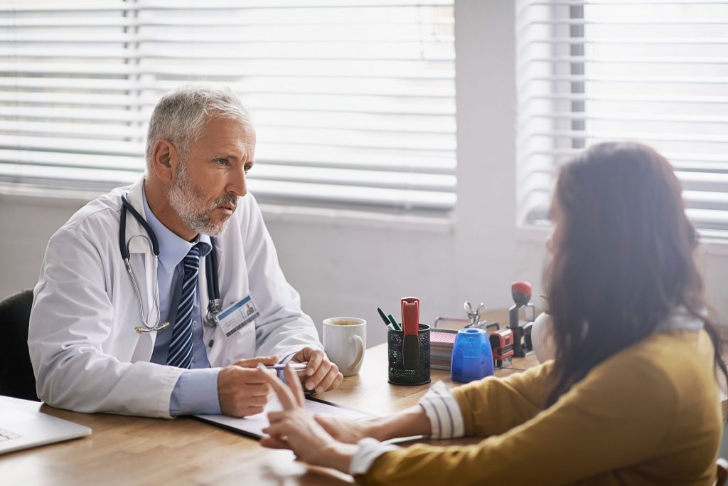 doctor discussing diagnosis with a woman patient