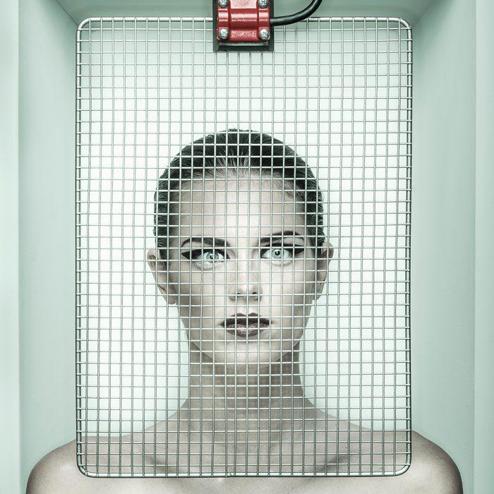 woman under mesh screen