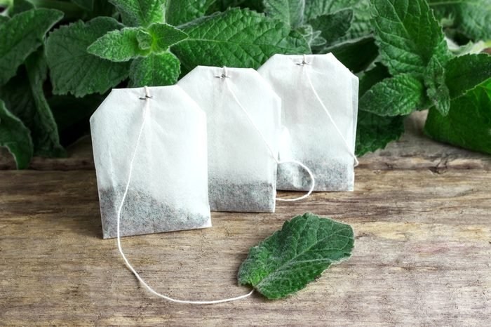 White tea bags with mint leaves