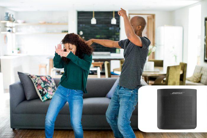 couple dancing in their living room. best buy bose bluetooth speaker.