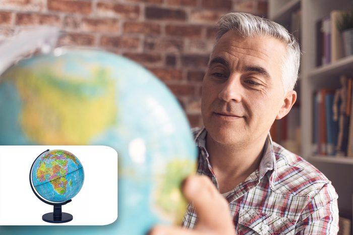 man looks at globe. target globe.