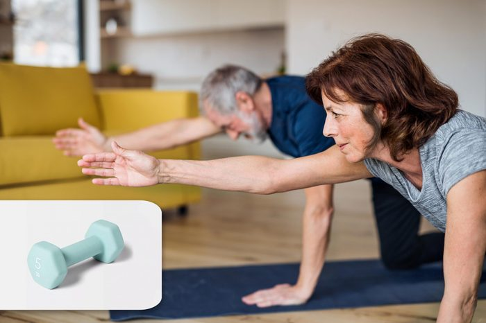 couple exercising at home. target hand weight.
