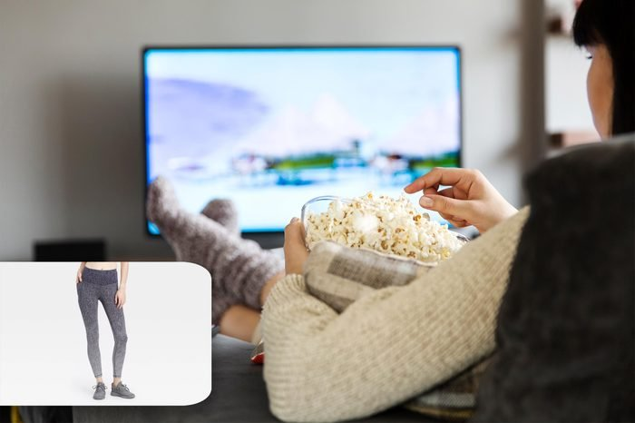 woman on the couch with popcorn. target leggings.