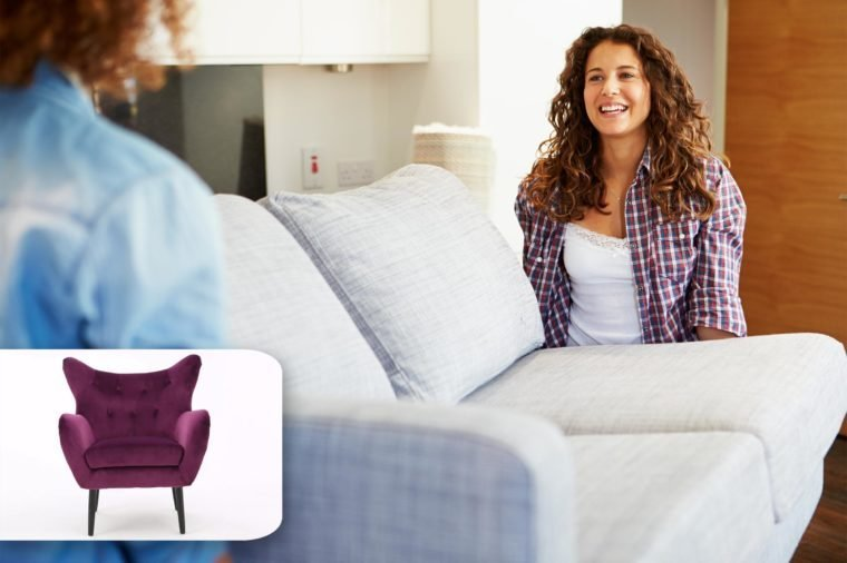 couple moving a couch. target accent chair.