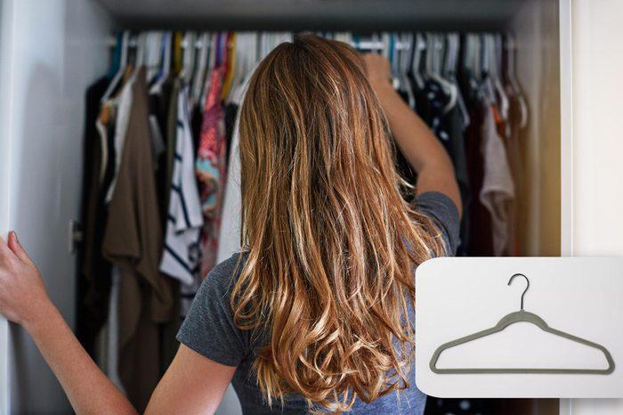 woman looks into her closet. target velvet hangers.