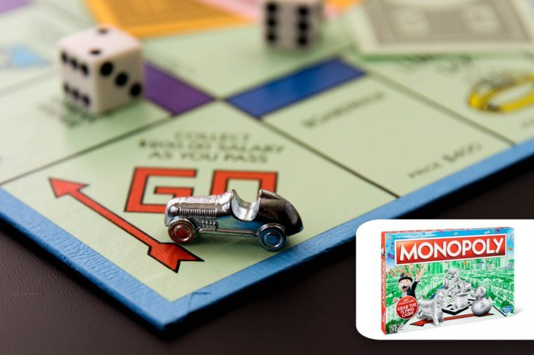 monopoly board, close up on go and car token. target monopoly.