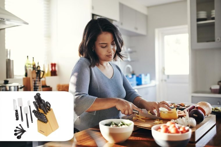 woman prepping food in her kitchen at home. target knives and kitchen tools set.