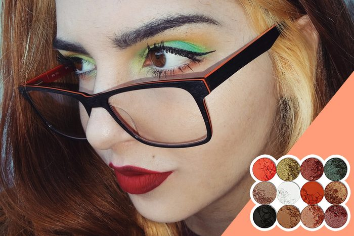 woman in glasses wearing colorful eyeshadow, with inset of eyeshadow pallet