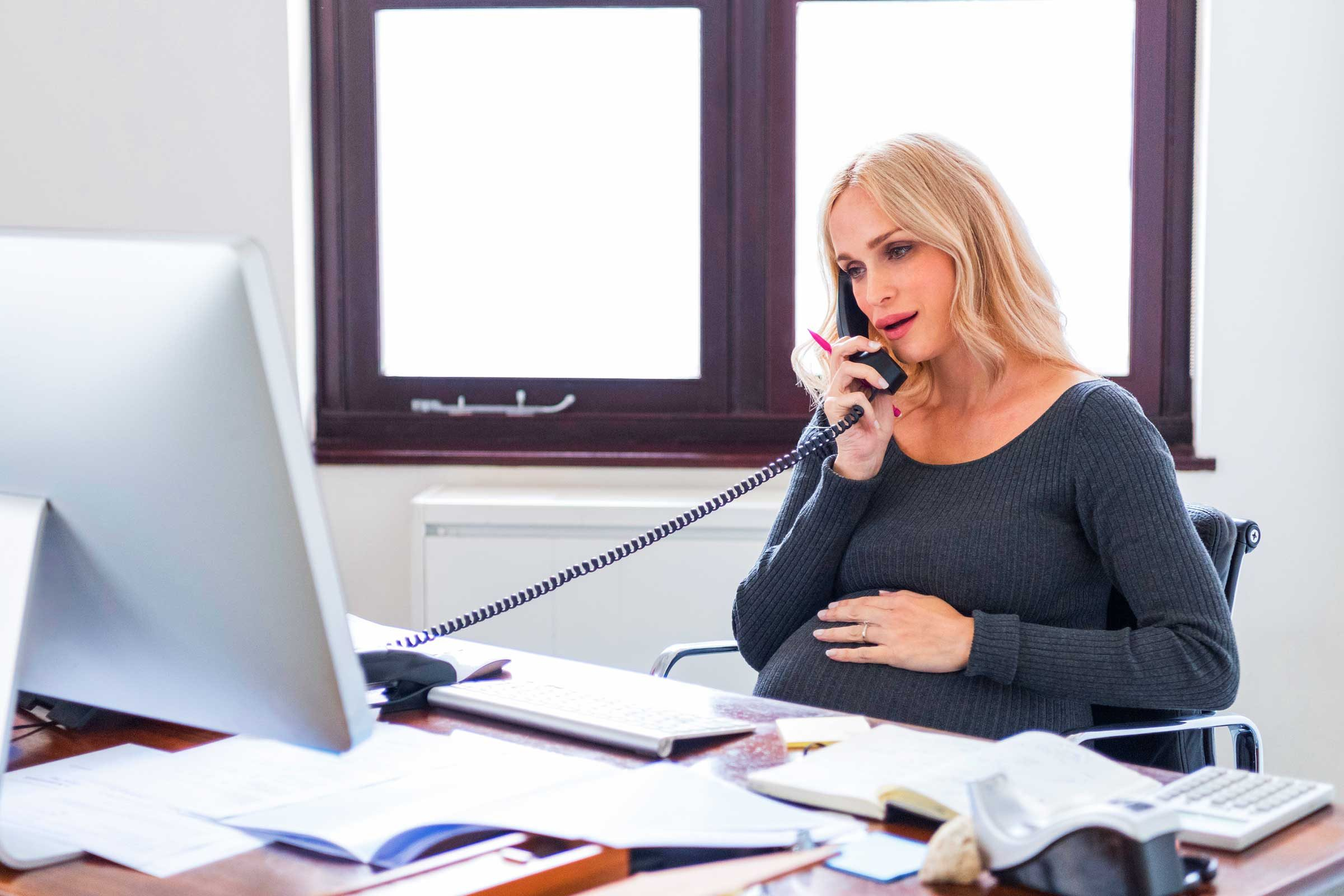 woman speaking on the phone in an office