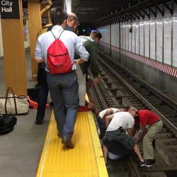 When a Man Falls onto Train Tracks, Three Strangers Jump Down After Him