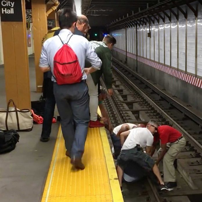 When a Man Falls onto Train Tracks, Three Strangers Jump Down After Him