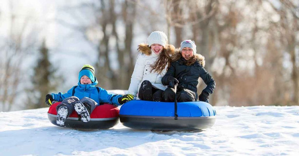 snowy_day_activities_whole_family_sledding_tubing