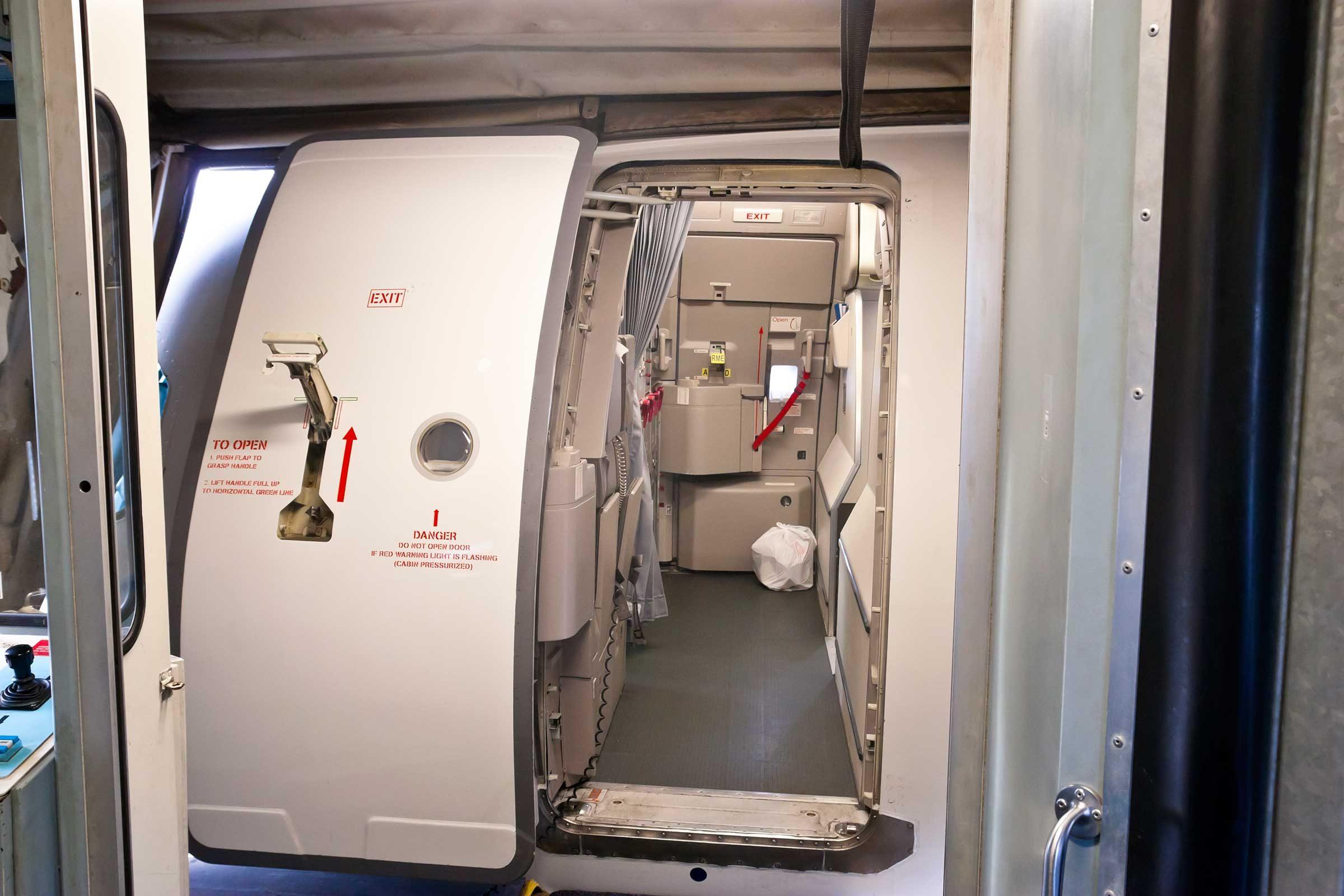 Can A Plane Door Actually Open Mid-flight? & Airplane Door \u0026 Stock Photo - Emergency Exit Door With Kitchen In ... Pezcame.Com
