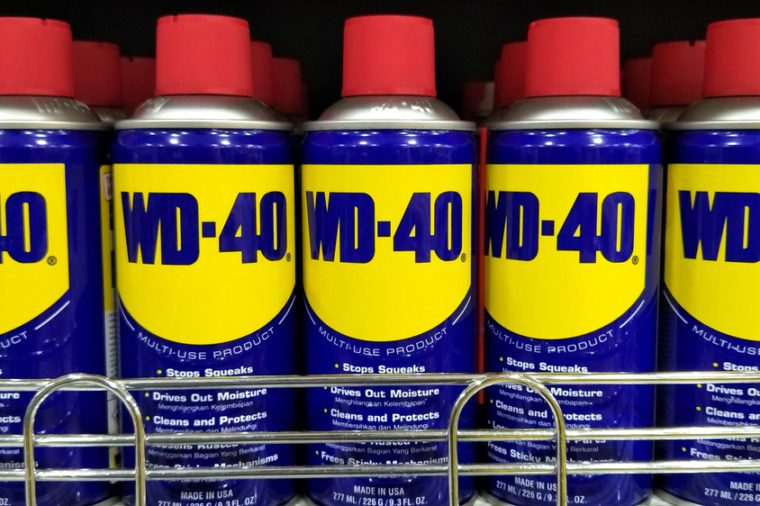 KUALA LUMPUR, MALAYSIA - DEC 24TH 2017: WD-40 canisters on the supermarket shelves. WD-40 is the trademark name of a penetrating oil and water-displacing spray.