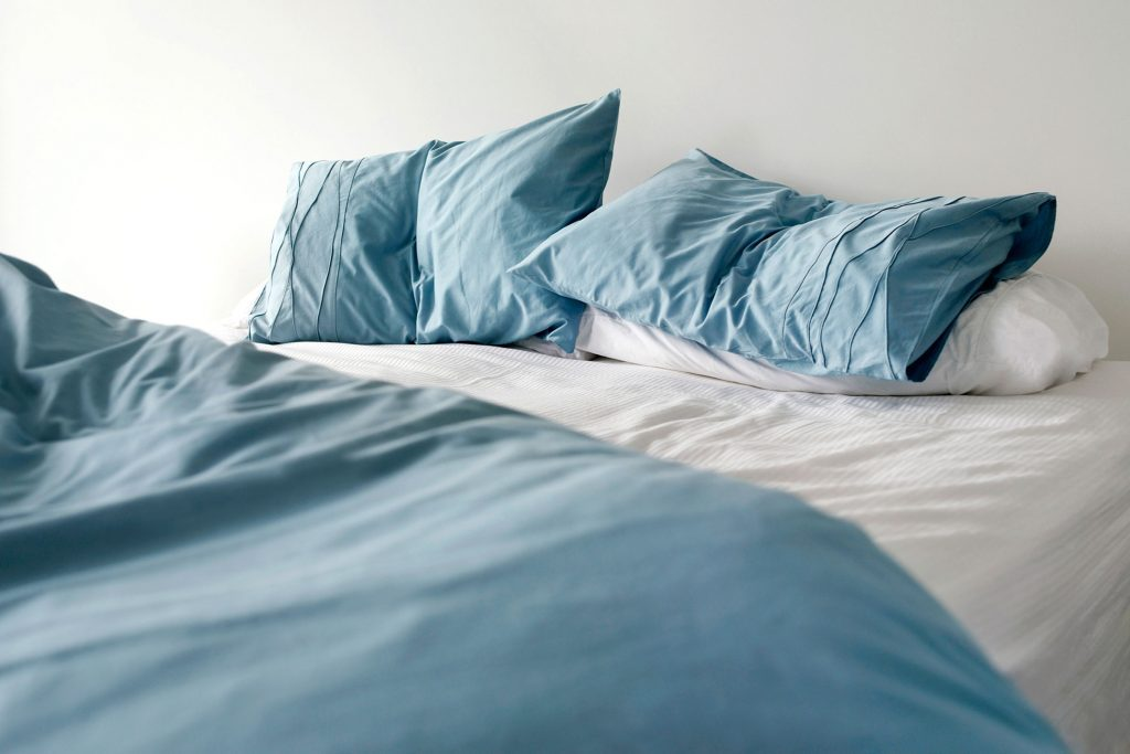 How Bad Is It To Sleep On Cheap Sheets? IStock/IPGGutenbergUKLtd. Buying  New Bedsheets ...