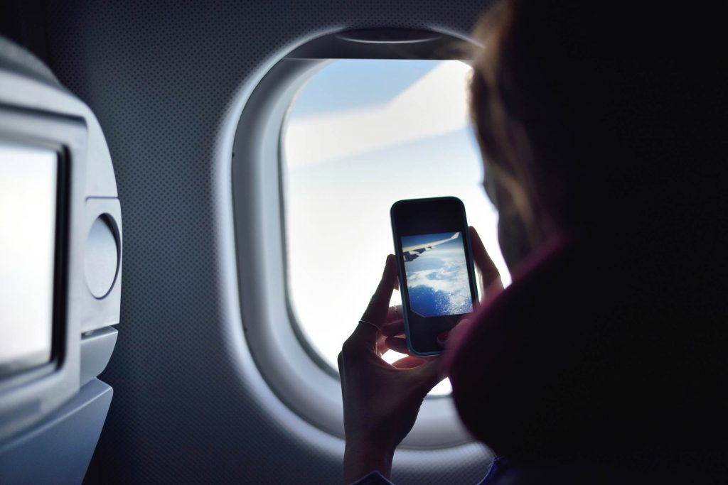 Image result for USING CELLPHONE INSIDE THE PLANE PIC