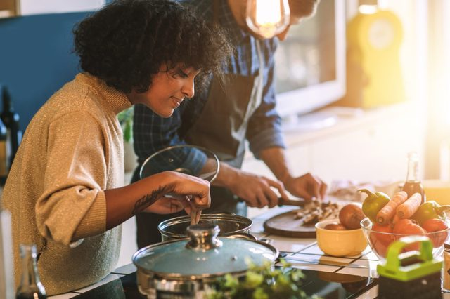 two adults cooking in the kitchen