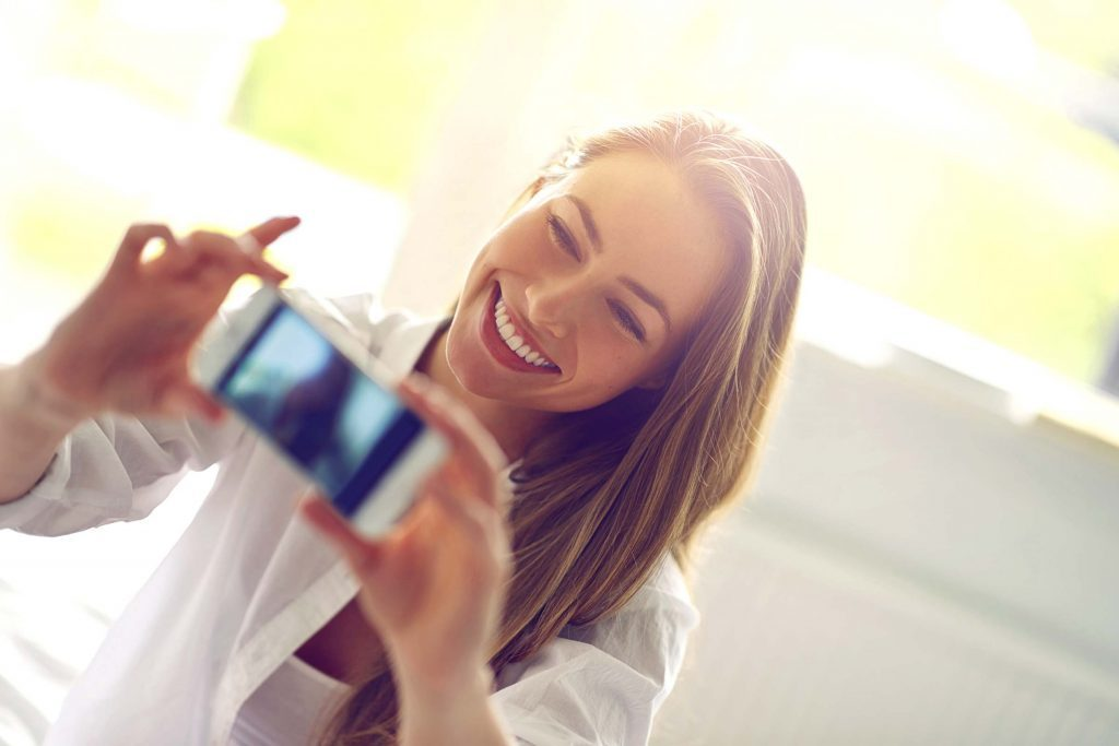Here's What People Really Think of Your Selfies