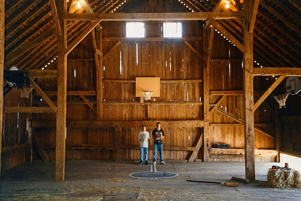 this old barn got a face lift and became a basketball court
