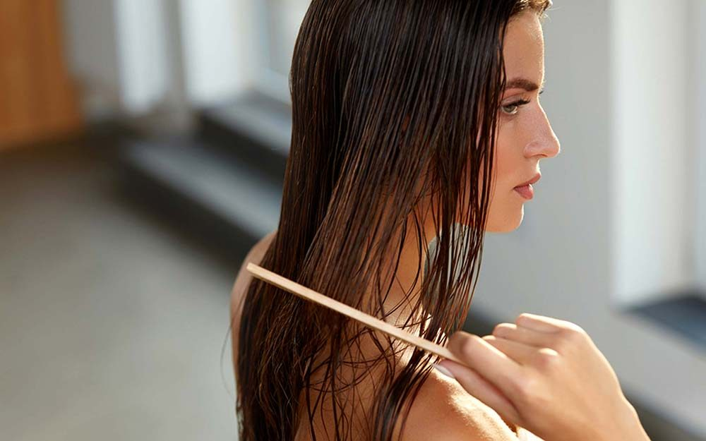 Growing Hair Out? Healthy Hair Tricks for Fewer Haircuts | Reader's Digest