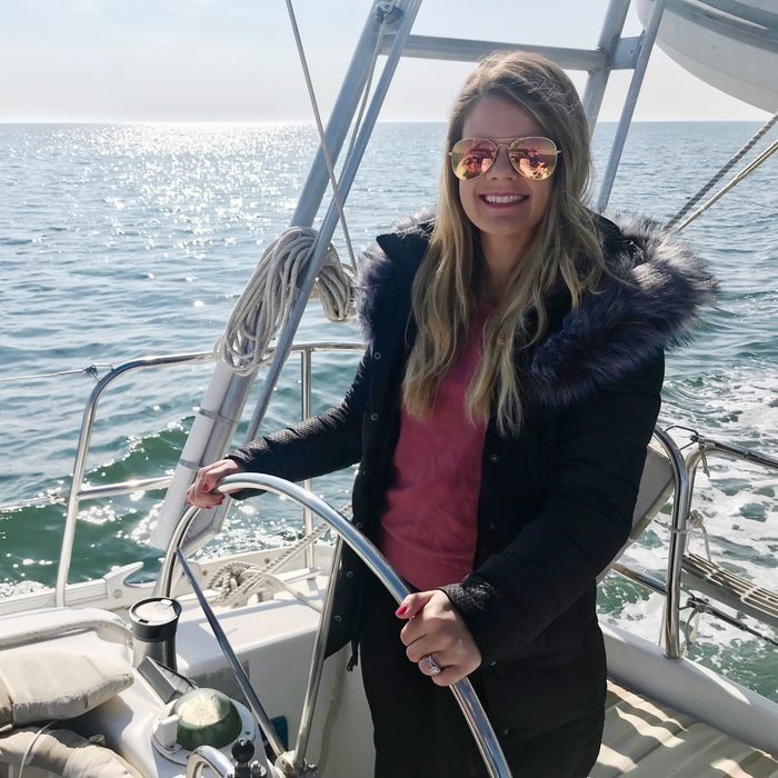 Rachel Hartley driving the boat to new york