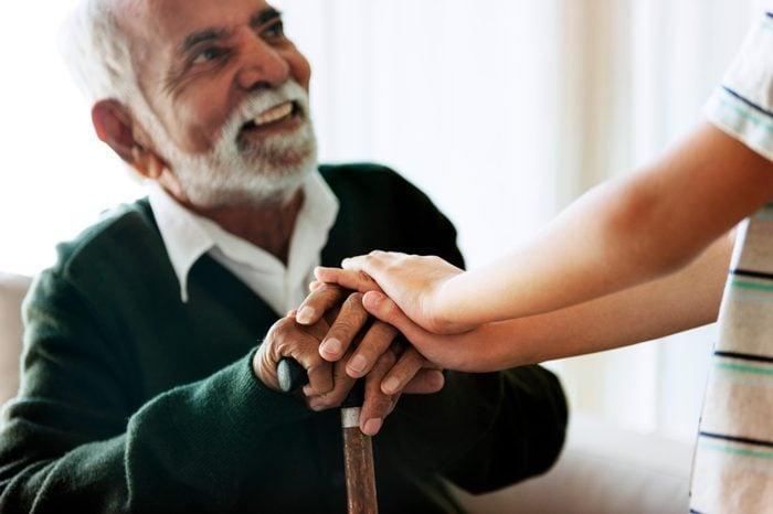 Grandson holding grandpa's hands