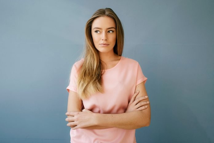 Portrait Of Young Woman Wearing Pink T Shirt