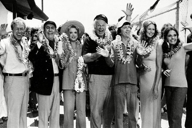 """Denver Hale Wells The cast of """"Gilligan's Island"""" poses during filming of a two-hour reunion show, """"The Return from Gilligan's Island,"""" in Los Angeles, Ca., . From left are, Russell Johnson, the professor; Jim Backus as Thurston Howell III; Natalie Schafer, Mrs. Howell III; Alan Hale Jr., the skipper; Bob Denver, as Gilligan; Judith Baldwin, as Ginger, the only new cast member; and Dawn Wells, as Mary Ann. It is the first new episode since the series left the networks 11 years ago"""