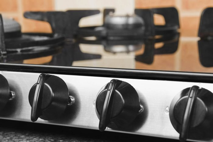 close up of knobs on a stove