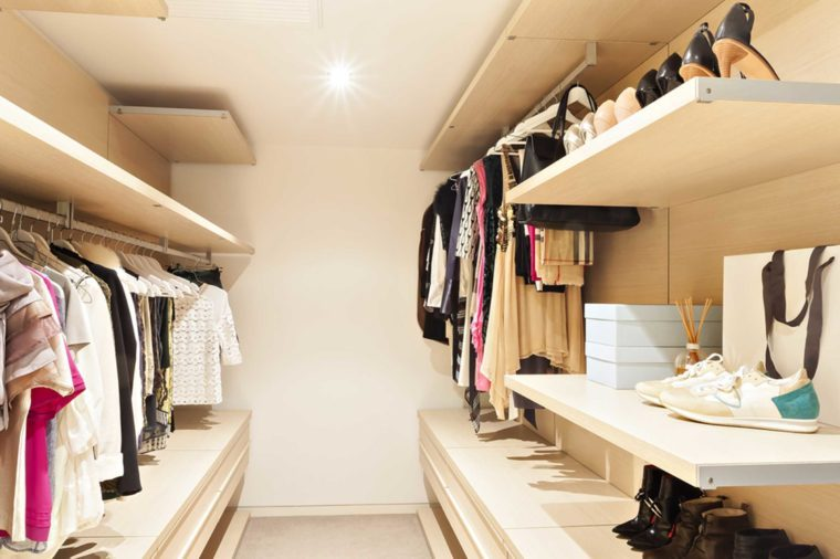 02-no-lighting-Biggest Closet Organizing Mistakes and Super-Easy Fixes_477113917-JR-stock
