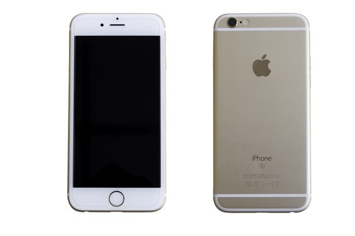 Bangkok, Thailand - January 1, 2017: Golden iPhone 7 on white background. The iPhone 7 is smart phone with multi touch screen produced by Apple Computer, Inc.