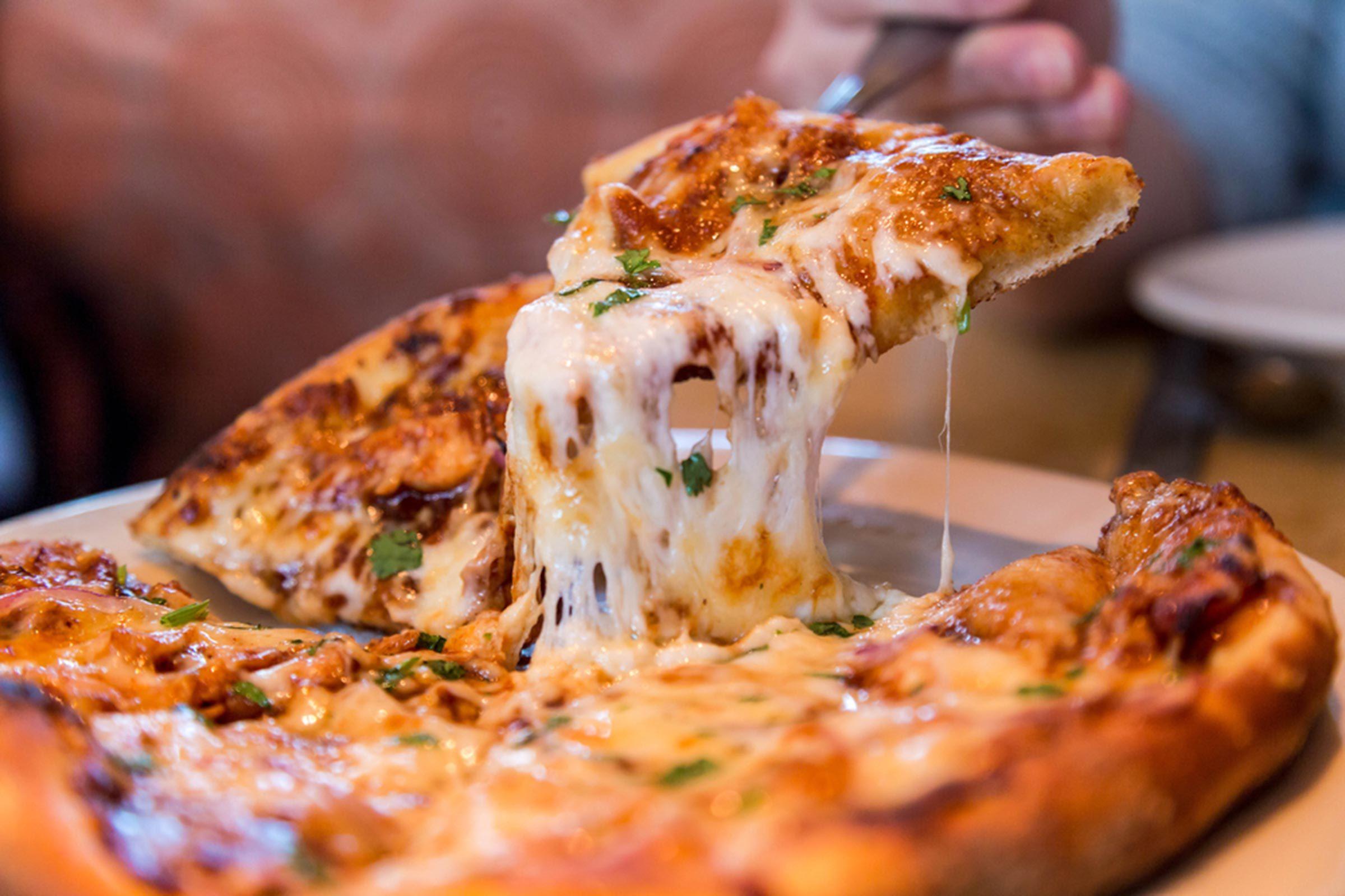 Slice of cheesy pizza