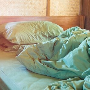 This-Is-Why-Not-Making-Your-Bed-Can-Actually-Boost-Your-Health_363295766_Rakopton-TanyakamLPN-ft
