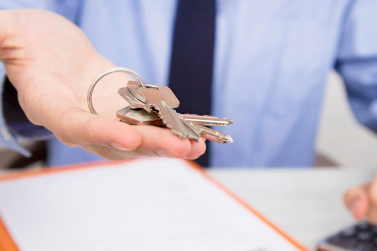 closeup of hands with keys of house, to buy house