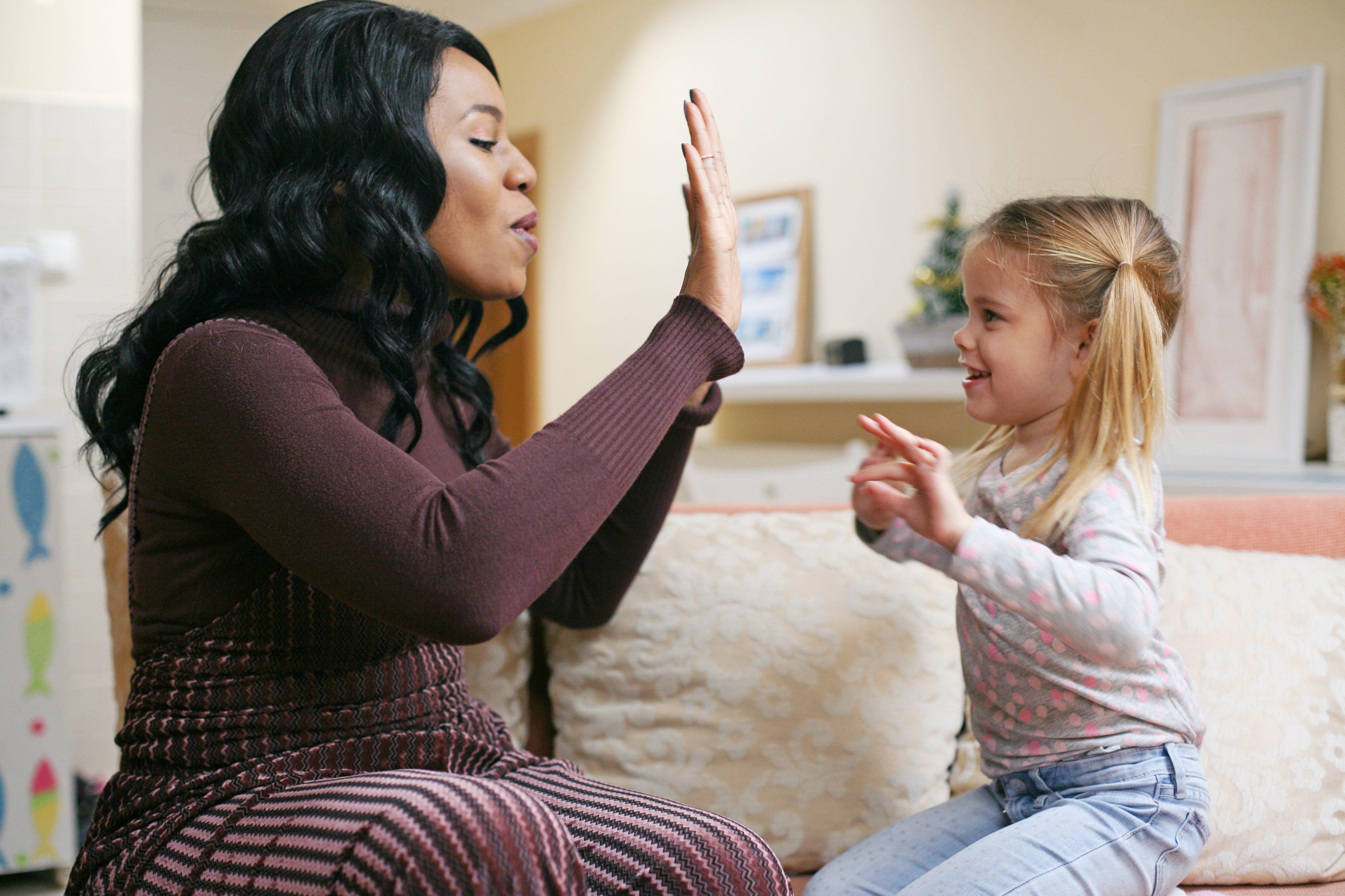 African American woman playing with girl.; Shutterstock ID 583567765; Job (TFH, TOH, RD, BNB, CWM, CM): RD