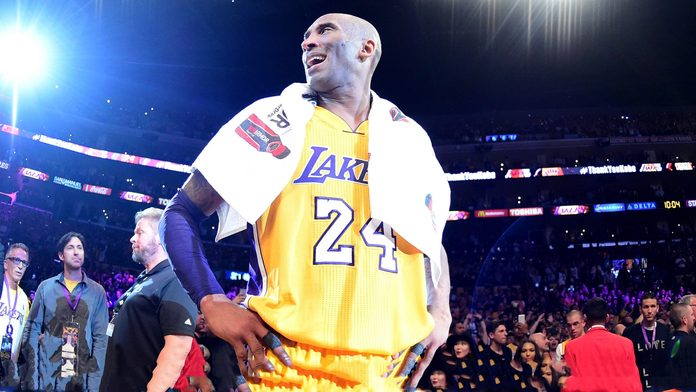 Kobe Bryant #24 of the Los Angeles Lakers celebrates after scoring 60 points in his final NBA game at Staples Center on April 13, 2016 in Los Angeles, California.