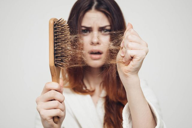 If-You've-Been-Shedding-More-Hair-Lately,-There's-a-Scientific-Reason-Why_557050852_Dmitry-A