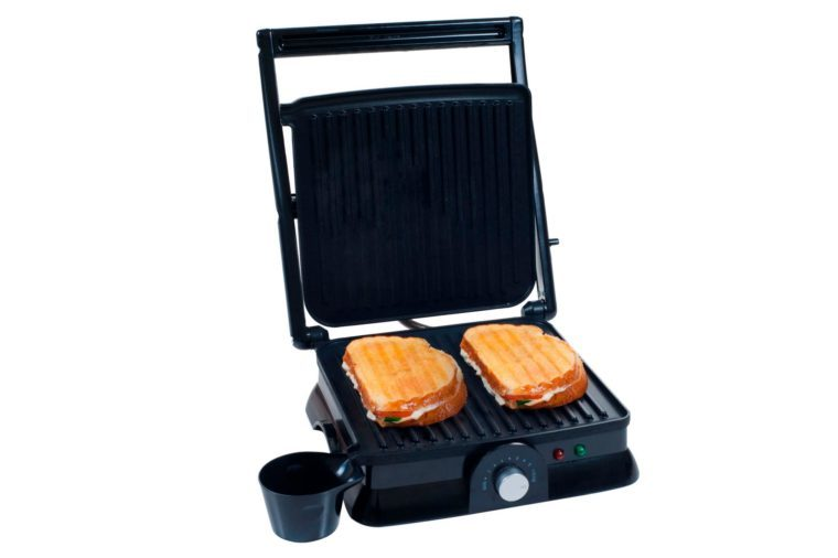 nonstick panini press grill open with sandwiches on the grill