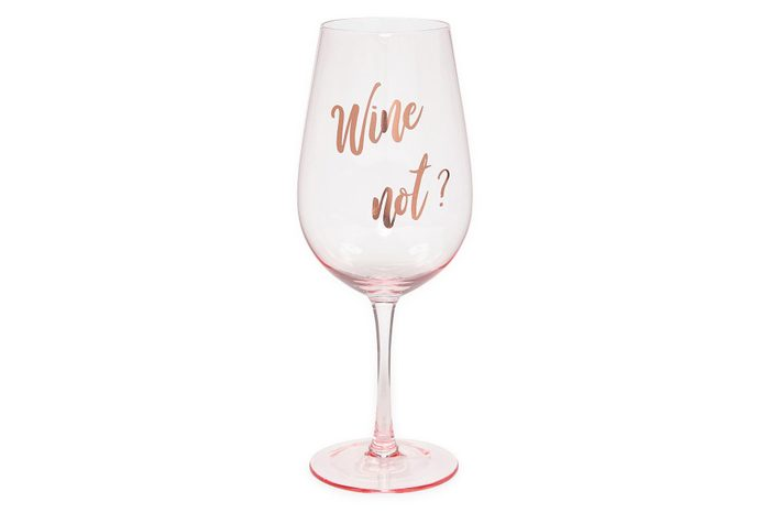 "party wine glass in pink with text that reads ""wine not?"""