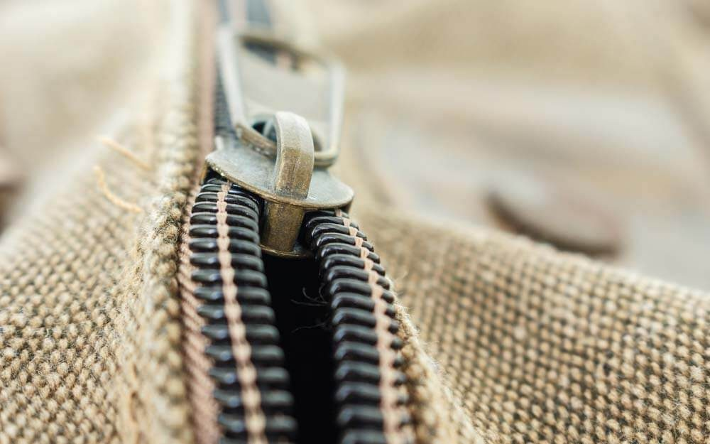 """Why Almost All of Your Zippers Have the Letters """"YKK"""" on Them"""
