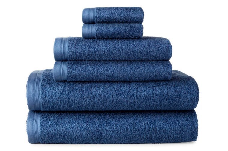 stack of folded blue towels of different sizes